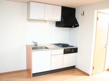 室内にあったデザインのキッチンが明るい雰囲気をつくりだしています。
